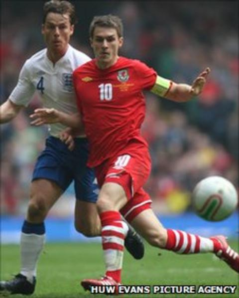 Aaron Ramsey in action against England's Scoptt Parker