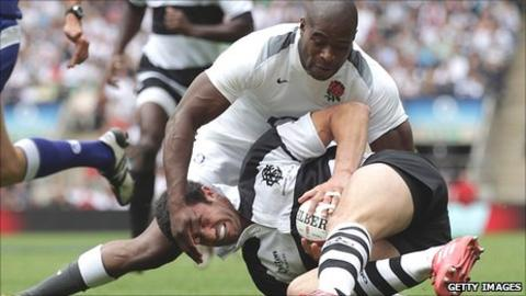 Ugo Monye challenges Barbarians full-back Nicolas Jeanjean for the ball before scoring England's second try