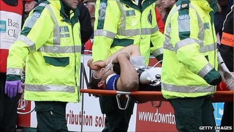 Olly Barkley is stretchered off with a broken leg