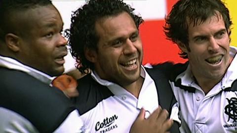 Barbarian players celebrate Isa Nacewa's match-winning try
