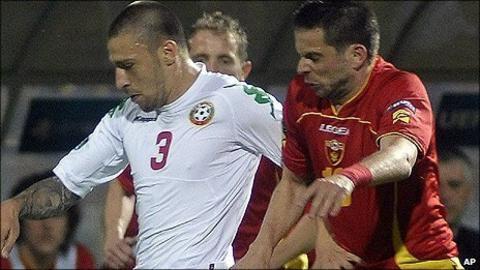 "Bulgaria""s Ivan Bandalovski, left, challenges for the ball with Radomir Djalovic of Montenegro"