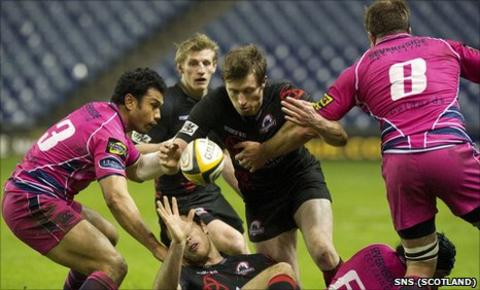 Edinburgh's Jim Thompson (centre) is closed down by Cardiff duo Casey Laulala and Xavier Rush (right)