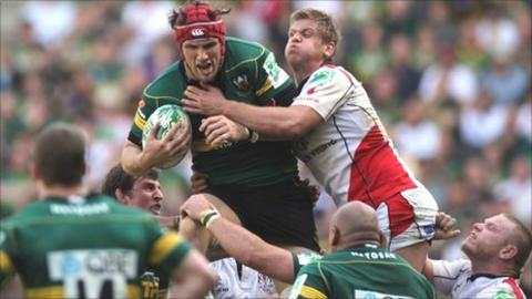 Northampton's Christian Day is tackled by Chris Henry of Ulster in last season's Heineken Cup quarter-finals