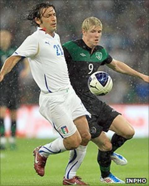 Andrea Pirlo of Italy comes under pressure from the Republic of Ireland's Andy Keogh