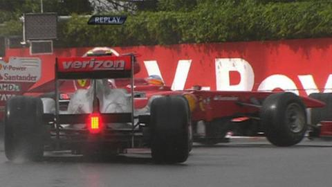 Button collides with Alonso