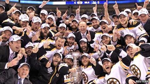 The Boston Bruins celebrate in Vancouver