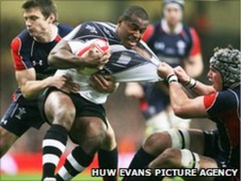 Fiji's Seremaia Bai is tackled by Wales' Danny Lydiate and Dan Biggar