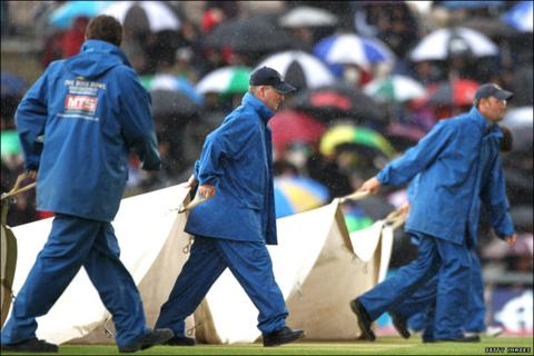 Groundsmen bring on the covers yet again on the third day of play at the Rose Bowl