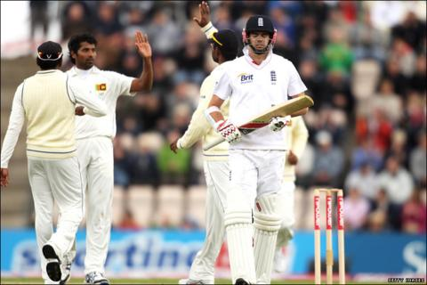 Nightwatchman James Anderson returns to the pavillion after his early dismissal