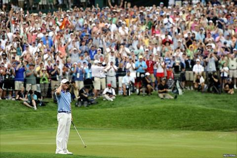 Rory McIlroy celebrates winning the US Open