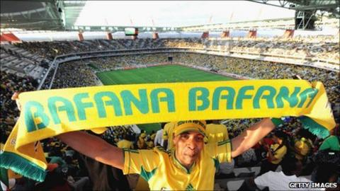 A South African supporter waves a Bafana Bafana scarf