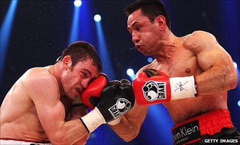 German boxer Felix Sturm (right) hits Matthew Macklin during their bout