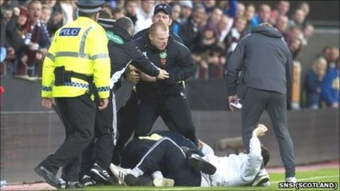 Celtic manager Neil Lennon is attacked by a fan at Tynecastle
