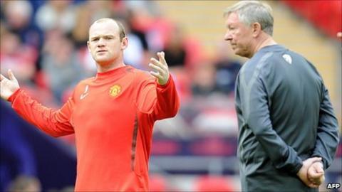 Manchester United striker Wayne Rooney and manager Sir Alex Ferguson