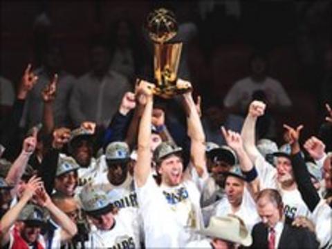 The Dallas Mavericks celebrate after winning the NBA Finals in June