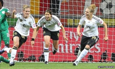 Simone Laudehr (left) celebrates her goal