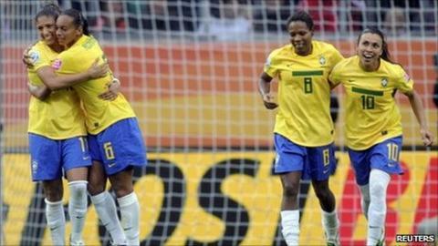 Brazil players celebrate a goal