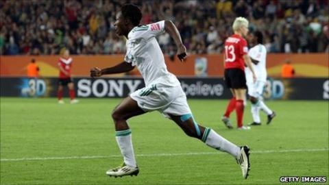 Nigeria's Perpetua Nkwocha celebrates scoring against Canada