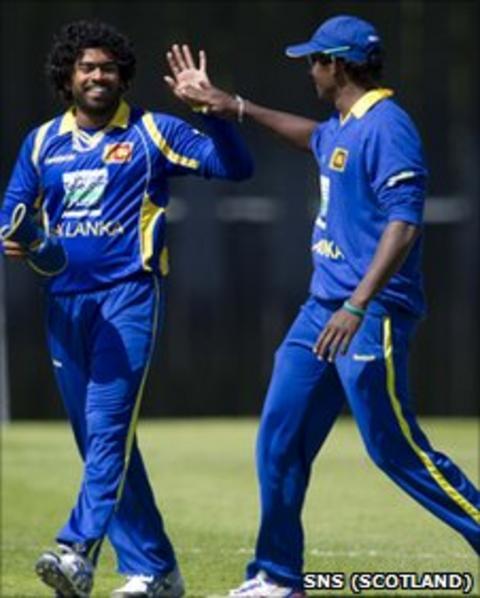 Sri Lanka's star opening bowler Lasith Malinga (left) celebrates another wicket with captain Tillakaratne Dilshan