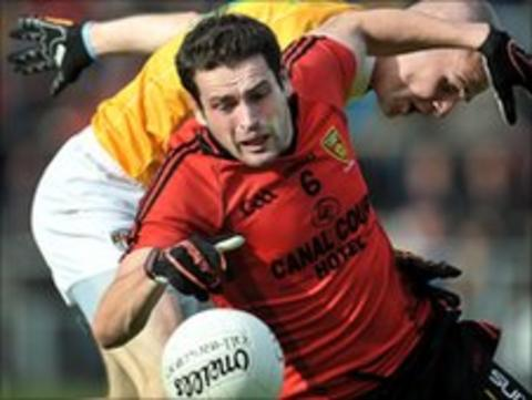 Down's Kevin McKernan moves clear of Aodhan Gallagher in the qualifier