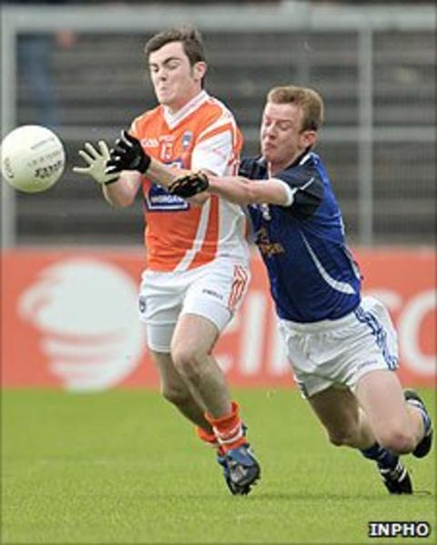 Armagh's Conor McNally competes against Brian Sankey of Cavan