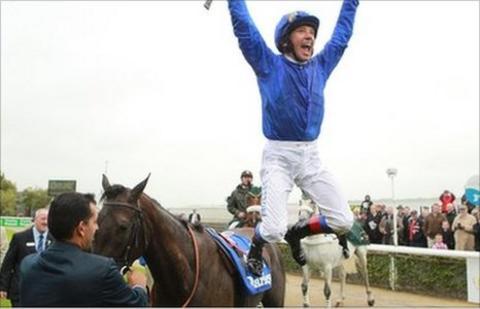 Frankie Dettori celebrates his win