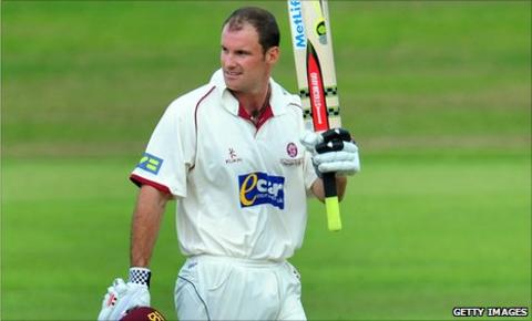 Andrew Strauss raises his bat after reaching his century