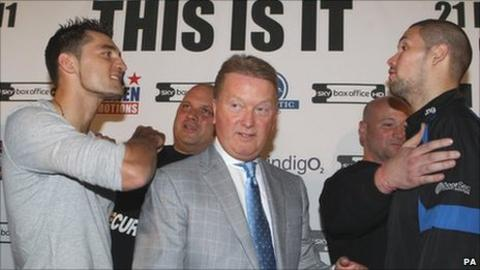 Nathan Cleverly (left) and Tony Bellew (right) are kept apart by promoter Frank Warren