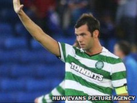Celtic and Wales midfielder Joe Ledley salutes the Cardiff fans