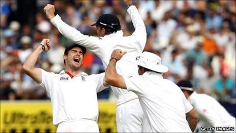 England's players celebrate after taking the final Indian wicket at Lord's