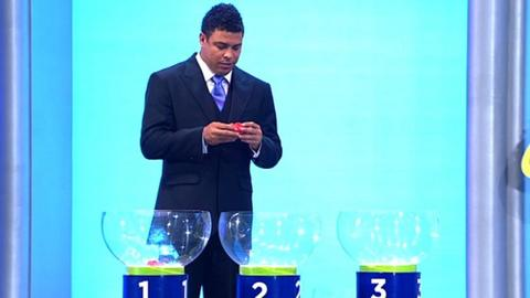 Ronaldo asists with the qualifying draw for the 2014 World Cup