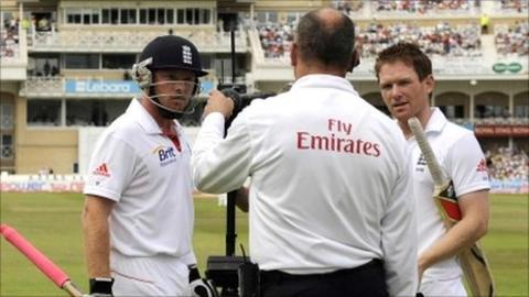 Ian Bell (left) talks to umpire Tim Robinson as Eoin Morgan watches on