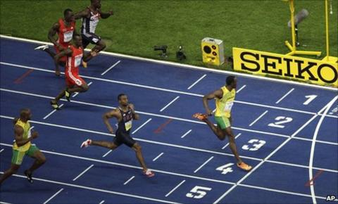 Asafa Powell (left) trails Usain Bolt (right)