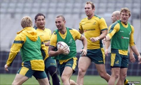 Quade Cooper (c) of Australia and team-mates at Eden Park