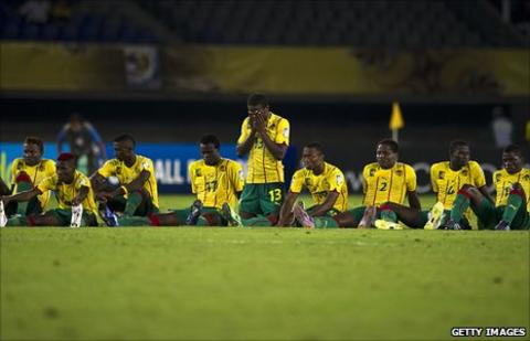Dejected Cameroon under-20 players after losing a penalty shoot-out