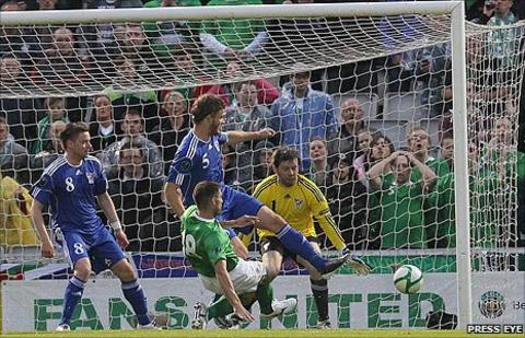 Aaron Hughes sends his shot in off the post to put Northern Ireland into the lead against the Faroe Islands