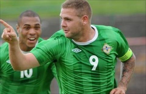 Josh Magennis runs to congratulate hat-trick hero Billy Kee