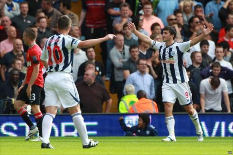 Shane Long (right) scores for West Brom