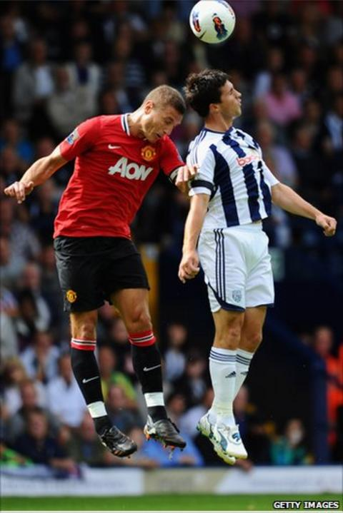Nemanja Vidic (left) and Shane Long (right)