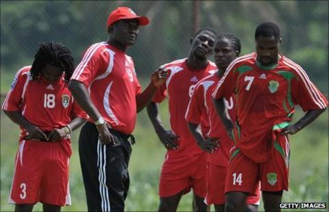 Malawi coach Kinnah Phiri (wearing cap)