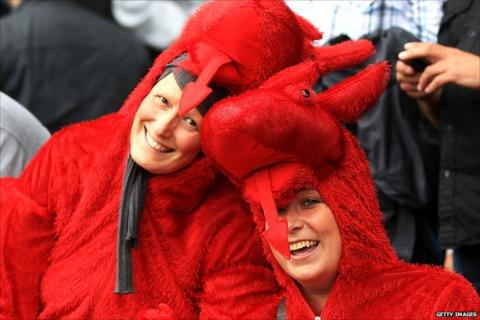 Swansea fans dressed as dragons
