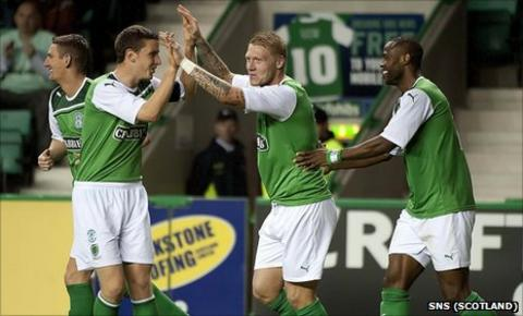 Hibernian players celebrate scoring against Berwick Rangers