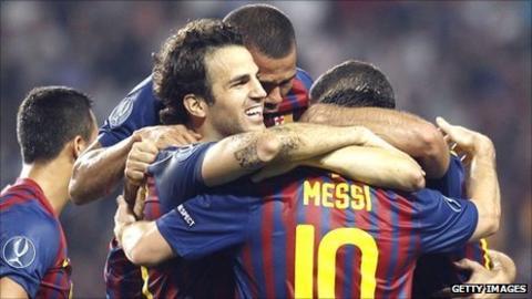 Cesc Fabregas (centre) celebrates his goal with Barcelona team-mates