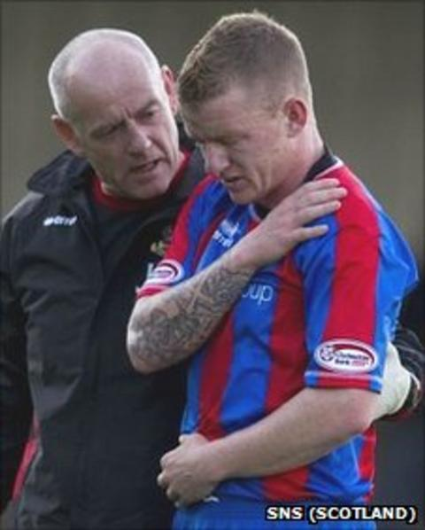 Jonny Hayes leaves the pitch at Somerset Park