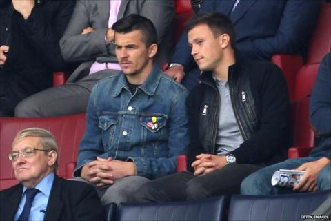 Joey Barton (left) watches QPR