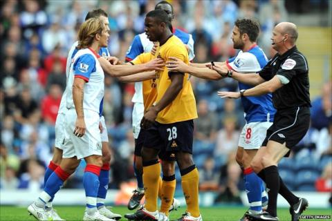 Michel Salgado and Victor Anichebe clash