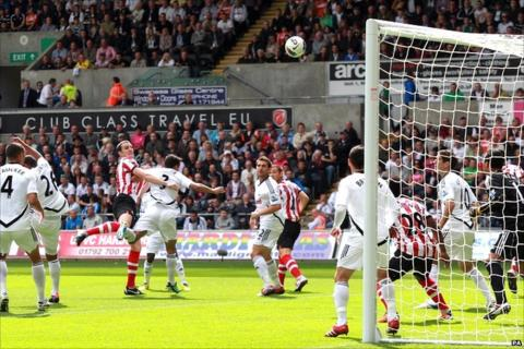 John O'Shea heads against the bar