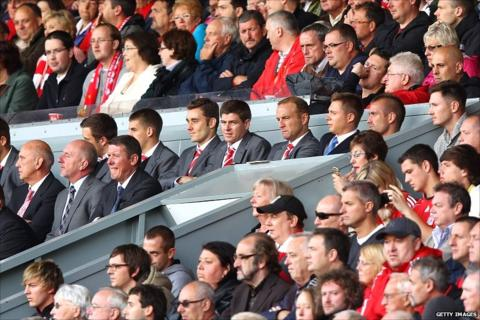 Steven Gerrard (centre) watches on at Anfield
