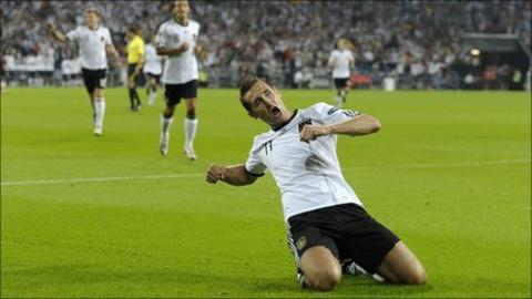 Miroslav Klose of Germany celebrates his team's first goal during