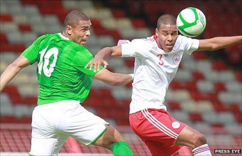 Josh Magennis of Northern Ireland in action against Denmark's Mathias Jorgensen